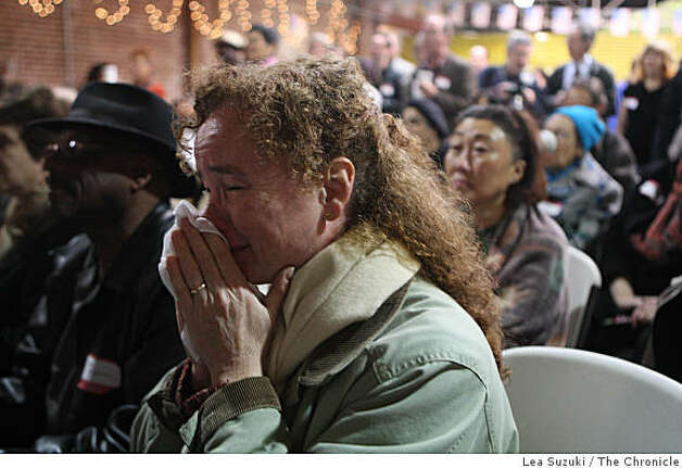 Mary Busby of Oakland wipes away tears as she watches coverage of the inauguration at Giovanna Tanzillo's inaugural viewing party at the Uptown Body and Fender shop in Oakland, Calif. on Tuesday January 20, 2009. Photo: Lea Suzuki, The Chronicle