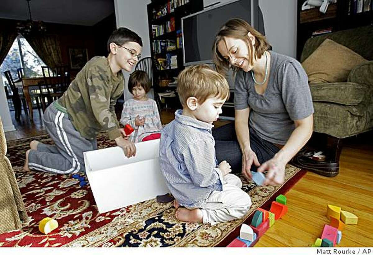 Kelly Whalen plays with her children Nathan, 11, left, Audrey, 4, and Aidan, 3, at their home in Exton, Pa., Monday, Jan. 12, 2009. (AP Photo/Matt Rourke)