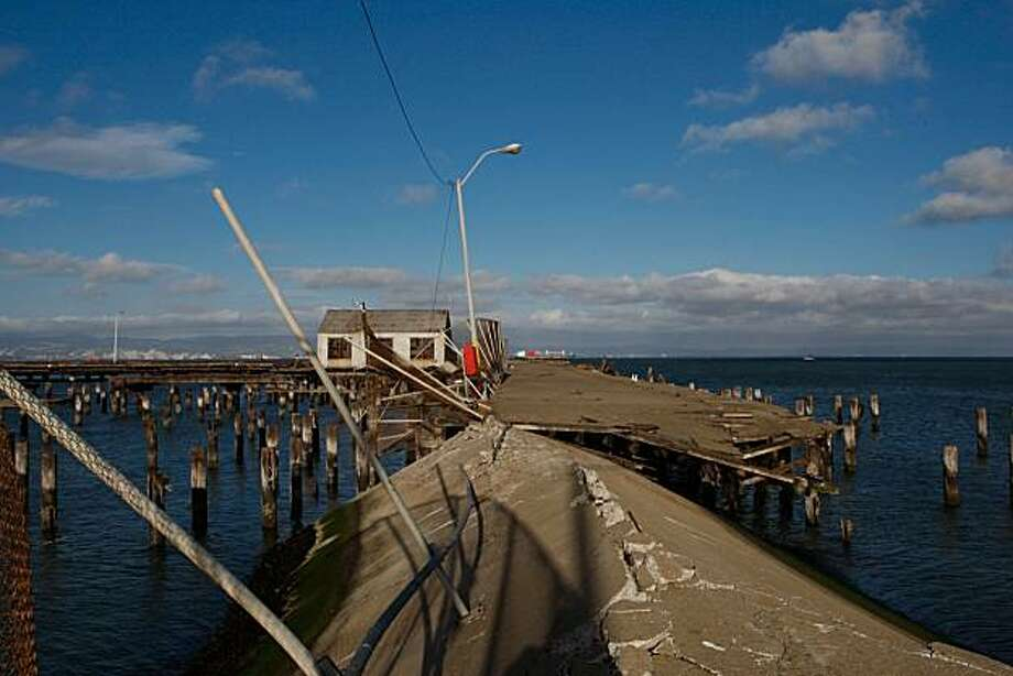 The dock of San Francisco's Pier 70 slipped into the water after years of being unused. Photo: John Sebastian Russo, The Chronicle
