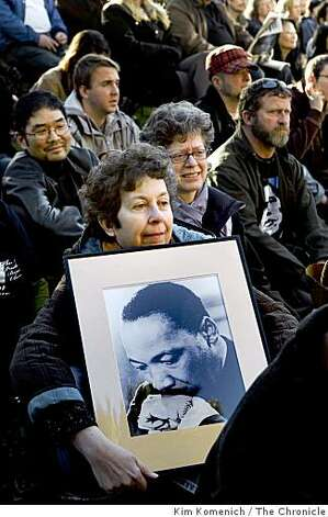 Ruth Borenstein of San Francisco holds a portrait of dr. Martin Luther King, Jr.  she and others gather to watch the inauguration of President-elect Barack Obama on two large television screens at Yerba Buena Gardens in San Francisco, Calif., on Tuesday, Jan. 20, 2009. Photo: Kim Komenich, The Chronicle