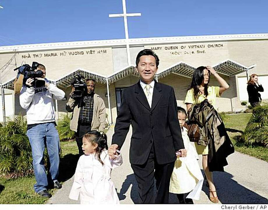 Republican Anh 'Joseph' Cao, center, leaves church with his daughters Betsy Cao, 4, Sophia Cao, 5, and his wife Kate Cao in New Orleans, Sunday, Dec. 7, 2008. Cao defeated Rep. William Jefferson, D-La., for the 2nd Congressional District in Louisiana, making him the first Vietnamese-American in Congress. (AP Photo/Cheryl Gerber) Photo: Cheryl Gerber, AP