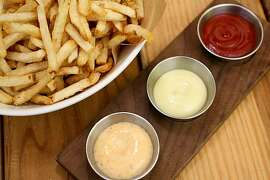 A bowl of fries made from Kennebec potatos and a trio of sauces, (top to bottom) organic ketchup, Basil Aioli and Old Bay Remoulade as served at Starbelly Restaurant on Friday, August 20, 2010 in San Francisco, Calif.