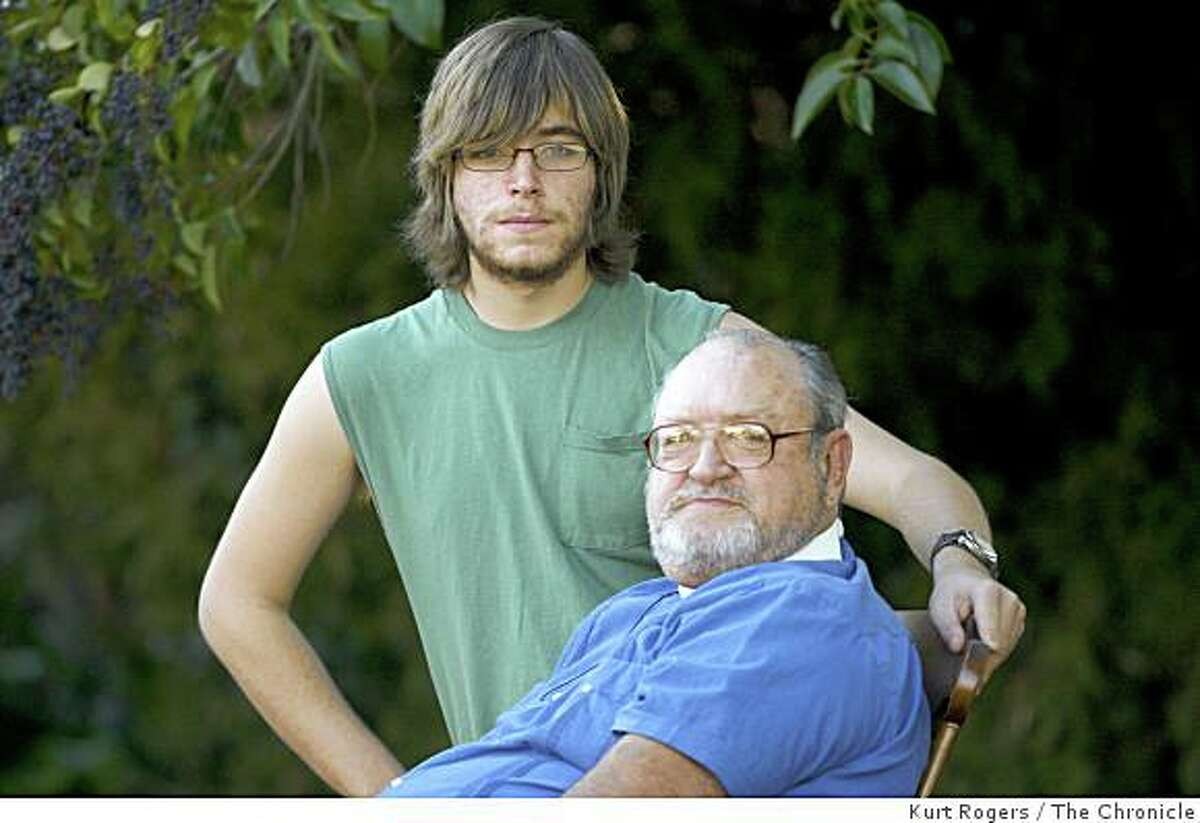 Patrick Spangler, 18, and his 64-year-old grandfather John Surinchak are being heralded as heroes after confronting a person who allegedly killed a person at an OfficeMax store in San Francisco. The pair held the suspected killer, Peter Fong, on the ground until police arrived. Spangler and Surinchak posed for a portrait in San Rafael, Calif., on Friday, Jan. 9, 2009.