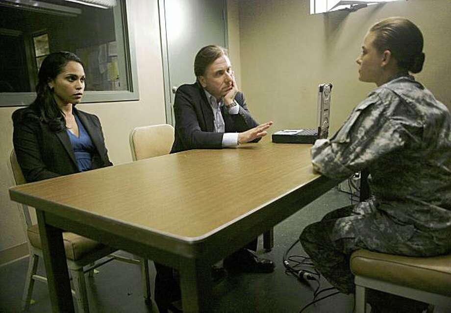 "LIE TO ME: Lightman (Tim Roth, C) and Torres (Monica Raymund, L) tackle a case within the U.S. Armed Forces in the LIE TO ME episode ""Moral Waiver"" airing Wednesday, Jan. 28 (9:00-10:00 PM ET/PT) on FOX. ©2009 Fox Broadcasting Co. Photo: Adam Taylor, FOX"