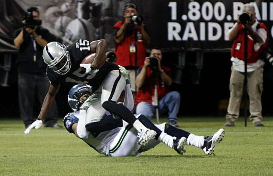 Oakland Raiders Johnnie Lee Higgins scores a touchdown in first quarter action with the Seattle Seahawks Thursday, Sept. 2, 2010 during their pre-season game at the Oakland Coliseum. Photo: Lance Iversen, The Chronicle
