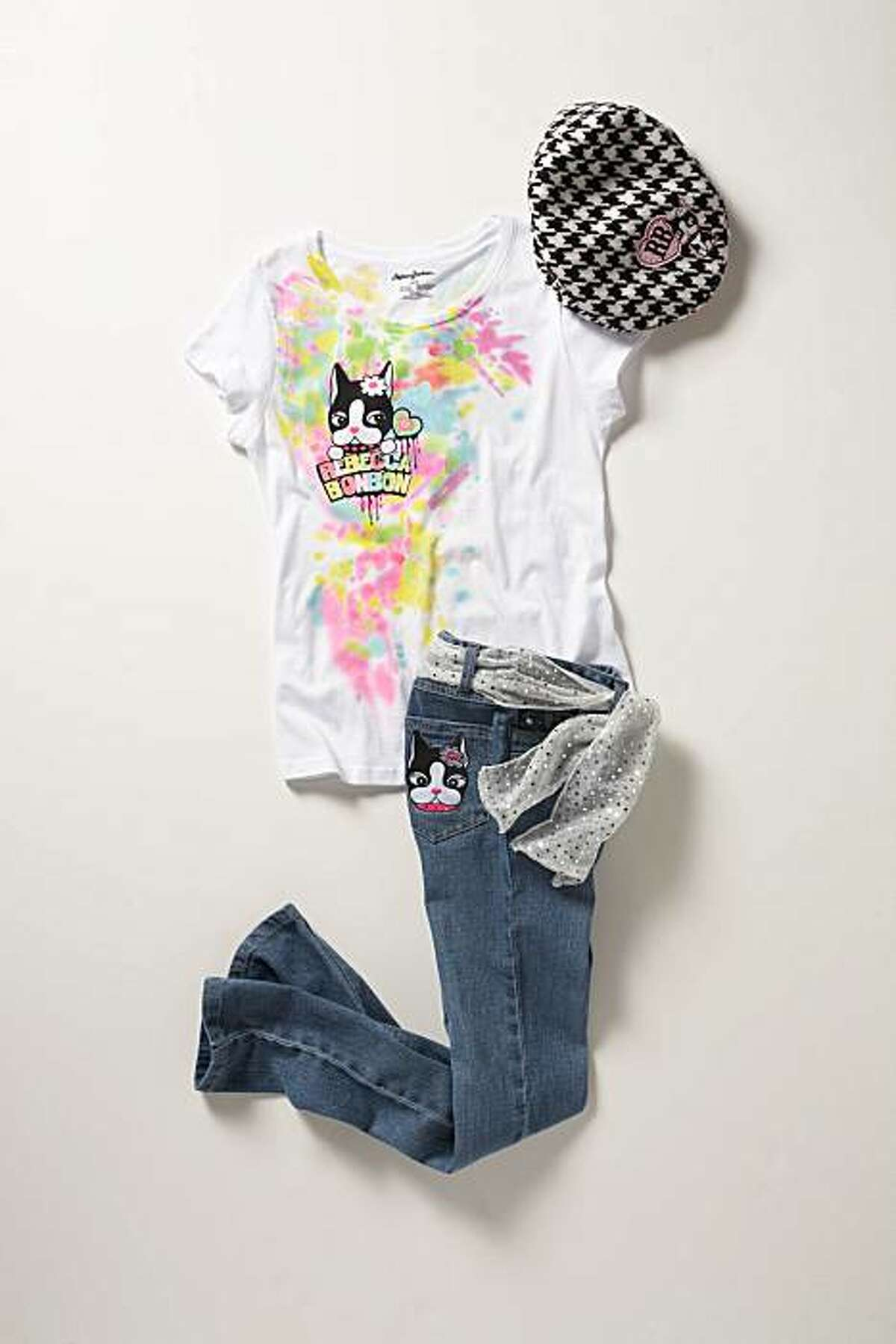 A girls' look from the Rebecca Bonbon collection: paint splatter tee ($9.99), skinny jean ($19.99) and houndstooth cabby hat ($6.99).