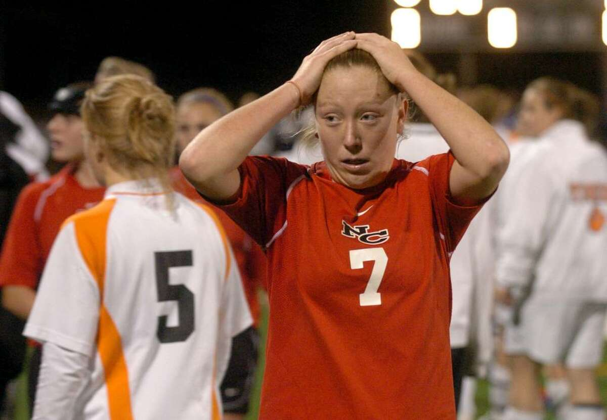 New Canaan's #7 Kasey Pippitt expresses disbelief after both New Canaan and Ridgefield were declared co-champions after double overtime with no score on either side, during FCIAC soccer in Norwalk on Wednesday Nov. 04, 2009.