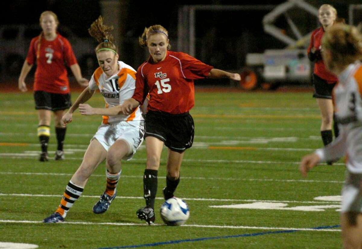 New Canaan's #15 Jana Persky, right, controls the ball as Ridgefield's #16 Kelly Baker tries to intercept, during FCIAC soccer in Norwalk on Wednesday Nov. 04, 2009. Both teams were declared co-champions after double overtime with no score.