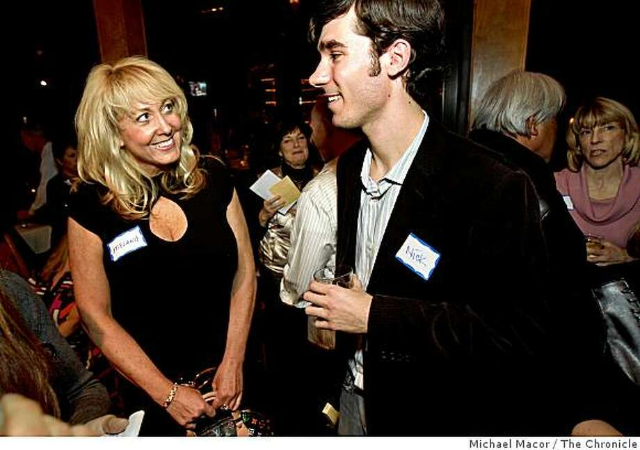 "Melanie Garrett, of Granite Bay and Nick Santoro of Oakland share a conversation during the ""Cougars"" single party at Faz Restaurant on Thursday Jan. 8, 2009, in Danville, Calif. Photo: Michael Macor, The Chronicle"