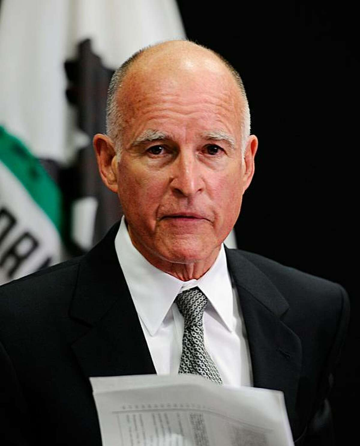 LOS ANGELES, CA - JULY 26: California Attorney General Jerry Brown holding a copy of a subpoena speaks during a news conference on July 26, 2010 in Los Angeles, California. Brown, who is also the democratic gubernatorial candidate, said his office has issued subpoenas for hundreds of employment, salary and other records from the city of Bell, as part of an investigation into the hefty salaries being paid to top administrators and elected officials.