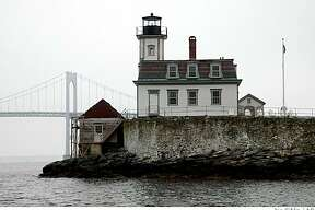 The Rose Island Lighthouse, shown April 26, 2004, in Newport, R.I., sits on the southern tip of Rose Island in the East Passage of Narragansett Bay, just below the Claiborne Pell Bridge (Newport Bridge), which replaced it as an aid to navigation when it was completed in 1969. The Rose Island Lighthouse Foundation, which purchased and restored the lighthouse and relit it in 1993, is now selling square foot lots on the island to pay for continued restoration.
