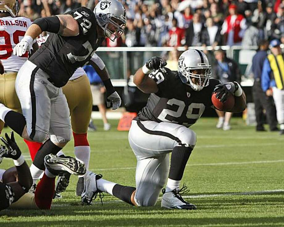 Oakland Raiders running back Michael Bush, right, celebrates after a rushing touchdown during the first half of a preseason NFL football game against the San Francisco 49ers in Oakland, Calif., Saturday, Aug. 28, 2010. Photo: Paul Sakuma, AP