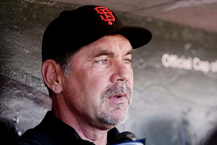 General Manager Bruce Bochy of the San Francisco Giants speaks to members of the media on pitcher Tim Lincecum's lower back injury at the team dugout at AT&T park in San Francisco, Calif. on Tuesday, Sept. 8, 2009. Giants minor league pitching prospect Madison Bumgarner, has been called up in place of Lincecum to start Tuesday's game against the visiting San Diego Padres. Photo: Stephen Lam, The Chronicle