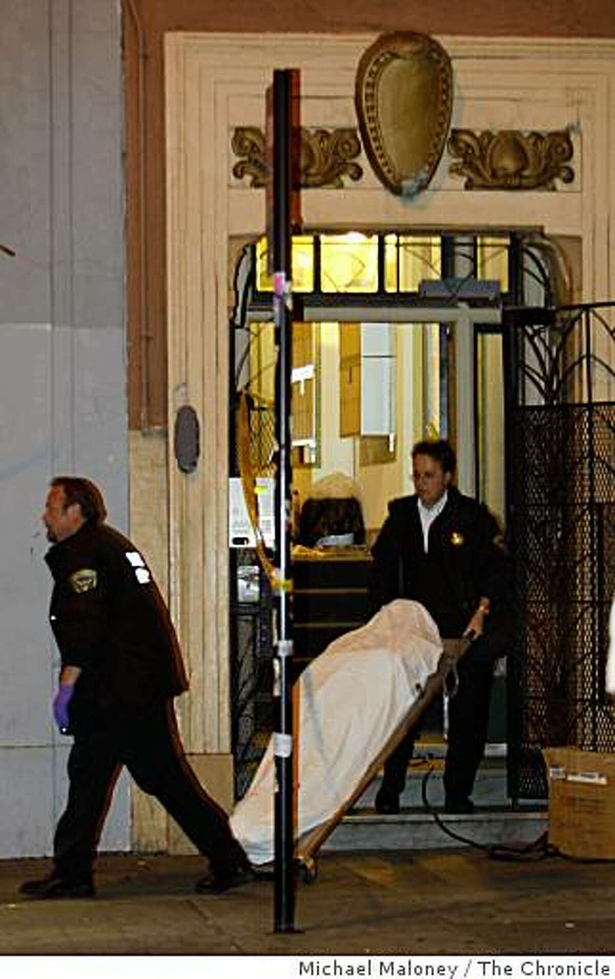 San Francisco coroners remove a body from the apartment at 816 Geary Street in San Francisco, Calif., where one person died on January 12, 2009 from a gas leak.
