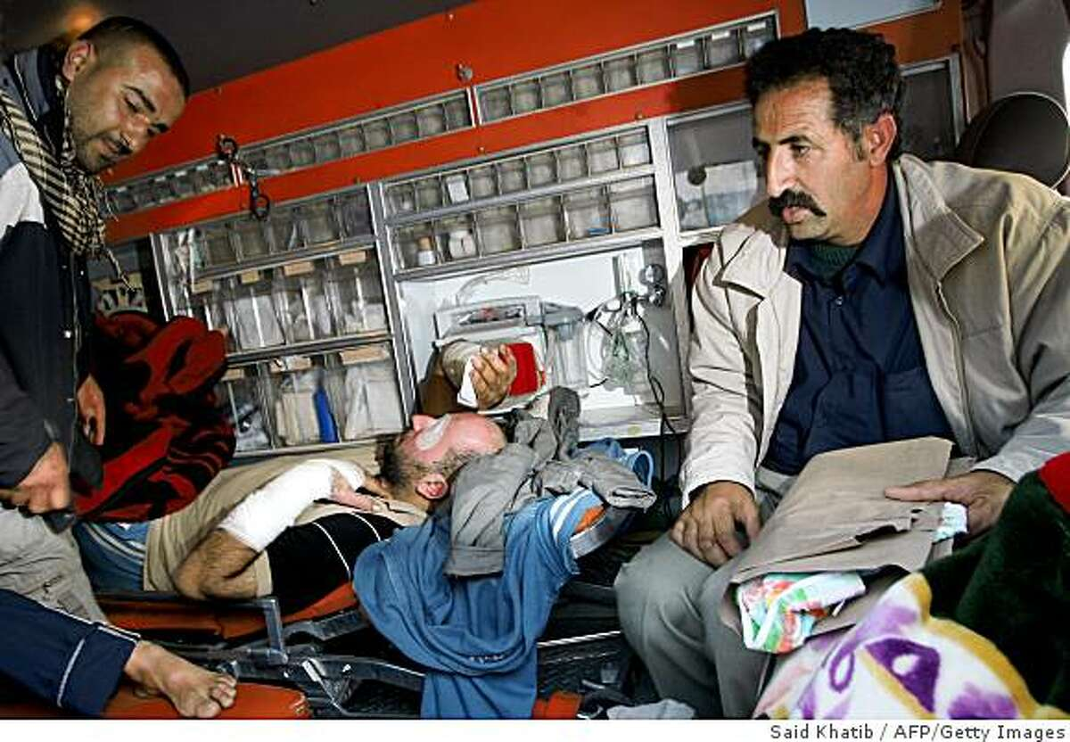 Wounded Palestinians wait in an ambulance to be evacuated through the Rafah border with Egypt on January 10, 2008 for tratment in various Arab countries. Fourteen Arab and foreign doctors arrived today to treat Palestinians wounded in Israel's punishing two-week-old offensive in the Hamas-ruled territory. AFP PHOTO/SAID KHATIB (Photo credit should read SAID KHATIB/AFP/Getty Images)