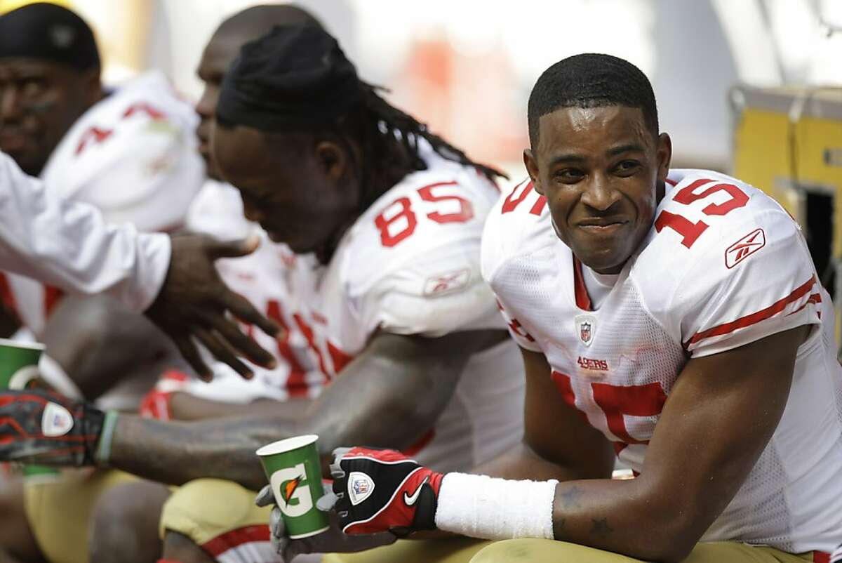 San Francisco 49ers wide receiver Michael Crabtree (15) and Vernon Davis (85) sit in the bench during the 2nd half of an NFL football game against the Houston Texans at Reliant Stadium Sunday, Oct. 25, 2009, in Houston. The Texans beat the 49ers 24-21. ( Brett Coomer / Chronicle )