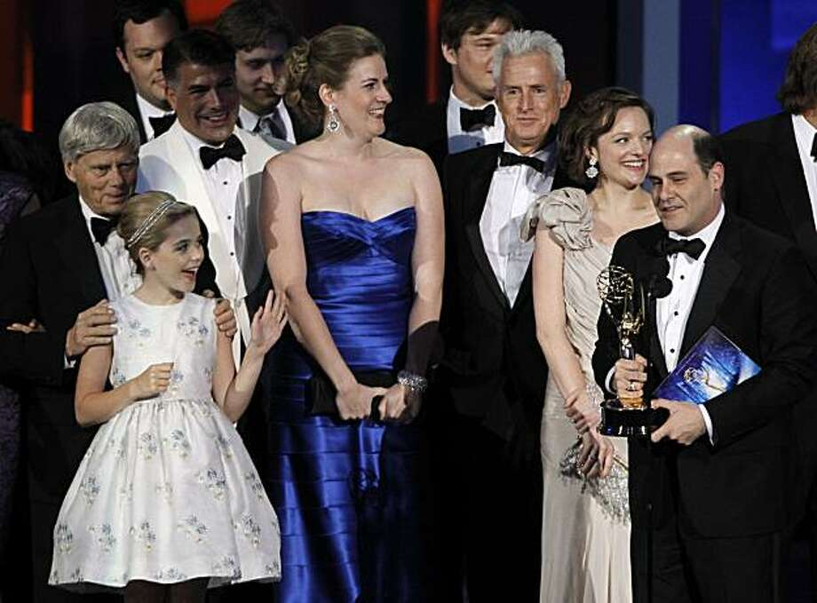 "Producer Matthew Weiner, right, is joined by cast members as he accepts the award for outstanding drama series for ""Mad Men"" during the 62nd Primetime Emmy Awards Sunday, Aug. 29, 2010, in Los Angeles. Photo: Chris Carlson, AP"