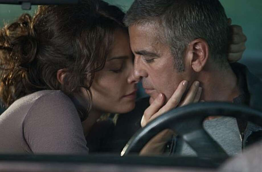 Violante Placido (left) and George Clooney (right) star in director Anton CorbijnÕs suspense thriller THE AMERICAN, a Focus Features release. Photo: Giles Keyte, Focus Features