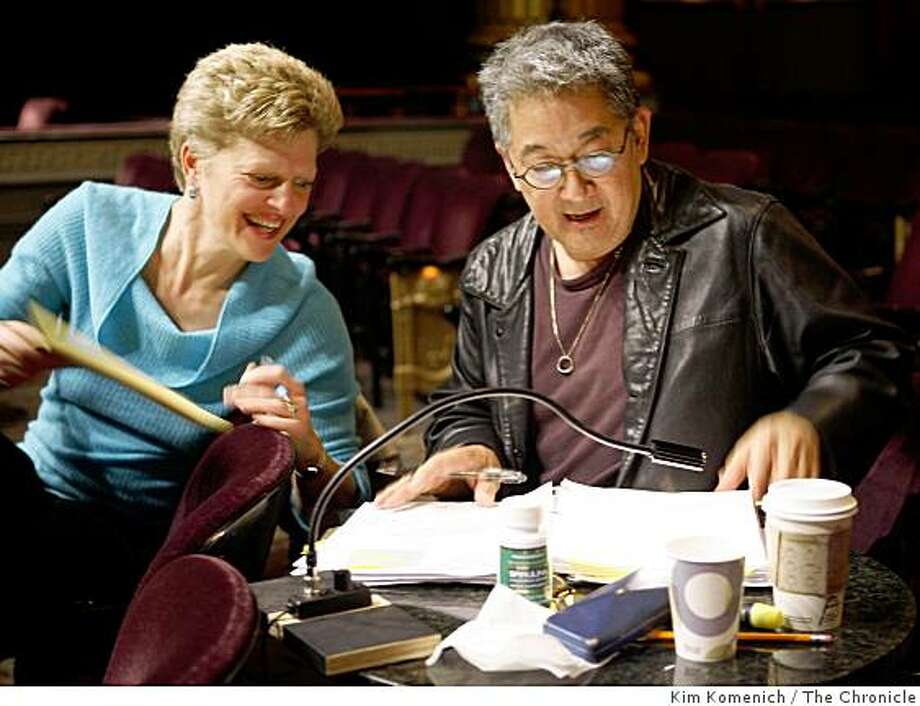 "Director Carey Perloff and playwright Philip Kan Gotanda go over script prior to dress rehearsal of ACT's production of ""After the War,"" about SF's Japantown when the internees started returning from the camps after WWII. Photo by Kim Komenich/The Chronicle **Carey Perloff, Philip Kan Gotanda Photo: Kim Komenich, The Chronicle"