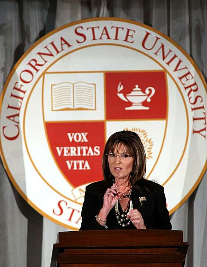 Former Republican vice presidential candidate Sarah Palin gestures during her speech at a fundraising dinner at California State University, Stanislaus in Turlock, Calif., Friday, June 25, 2010.  Palin's  speech has generated intense scrutiny since the nonprofit foundation holding the event first announced her visit in March.  University officials have refused to divulge the terms of her contract or her speaking fee. Photo: Rich Pedroncelli, AP