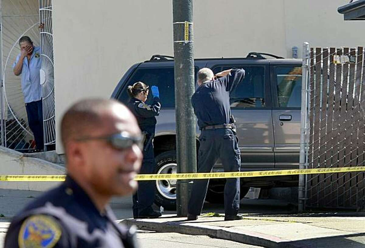 Police officials photograph and investigate the area around the Ford SUV where an SUV plowed into a group of five pedestrians waiting for a bus in the Visitacion Valley, San Francisco, on Tuesday August 24, 2010.