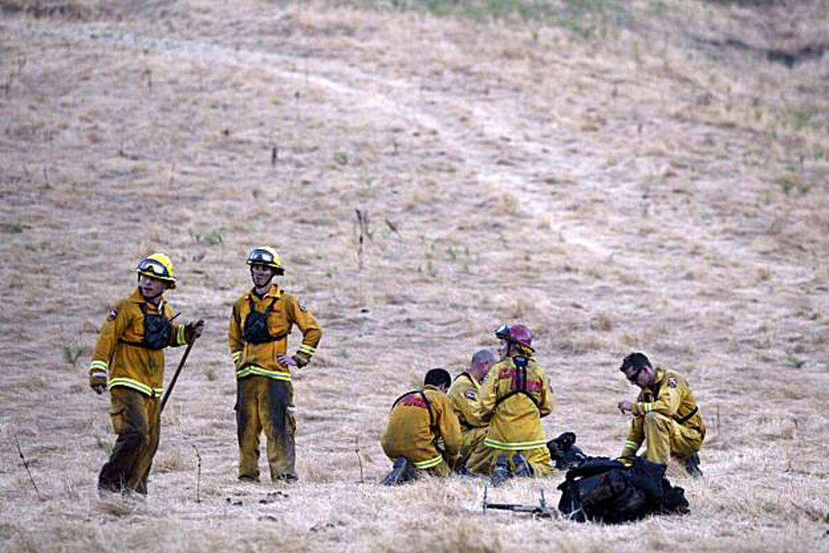 Cal Fire firefighters wait for a helicopter to pick them up up on the outskirts of Mount Diablo State Park in Clayton, Calif., on Tuesday, Aug. 24, 2010. (Ray Chavez/Staff) ** MAGS OUT/MANDATORY CREDIT **