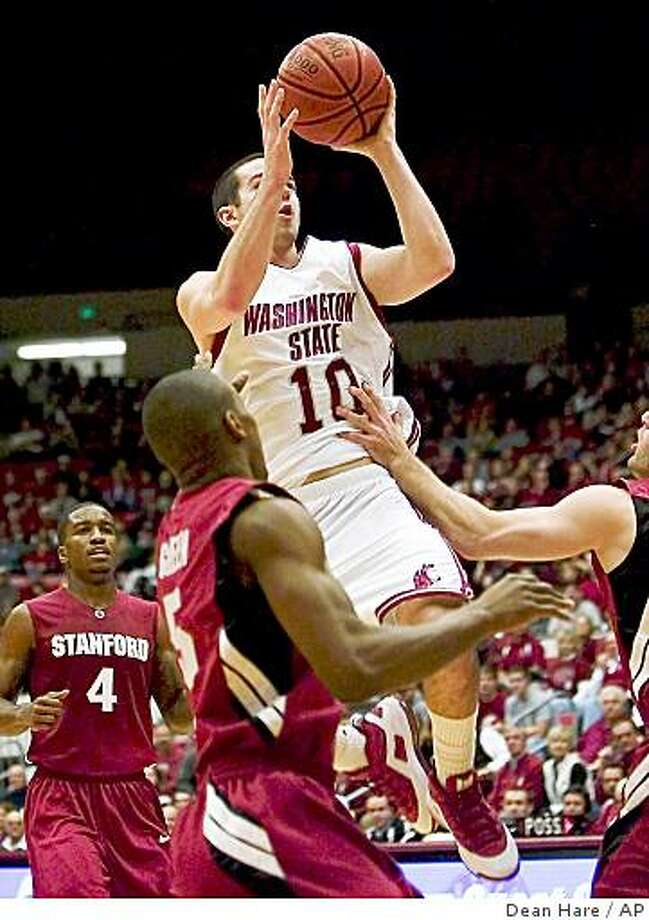 Washington State guard Taylor Rochestie (10) shoots over Stanford guard Drew Shiller, right, as Jeremy Green (5) and Anthony Goods (4) look on during the second half of an NCAA college basketball game Saturday, Jan. 10, 2009 at Friel Court in Pullman, Wash. Washington State won 55-54. (AP Photo/Dean Hare) Photo: Dean Hare, AP