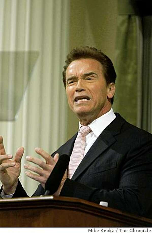 Acknowledging a grim fiscal picture for California budget issues, Gov. Arnold Schwarzenegger gives his State of the State speech in the assembly chambers of the State Capitol building on Thursday in Sacramento. Photo: Mike Kepka, The Chronicle