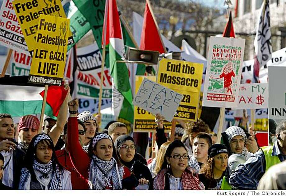 Pro-Palestinian demonstrators carrying signs made their way from the civic center on to Market where this photo was taken then over to Mission and back to the Civic center.. on Saturday Jan 10,  2009 in San Francisco , Calif Photo: Kurt Rogers, The Chronicle