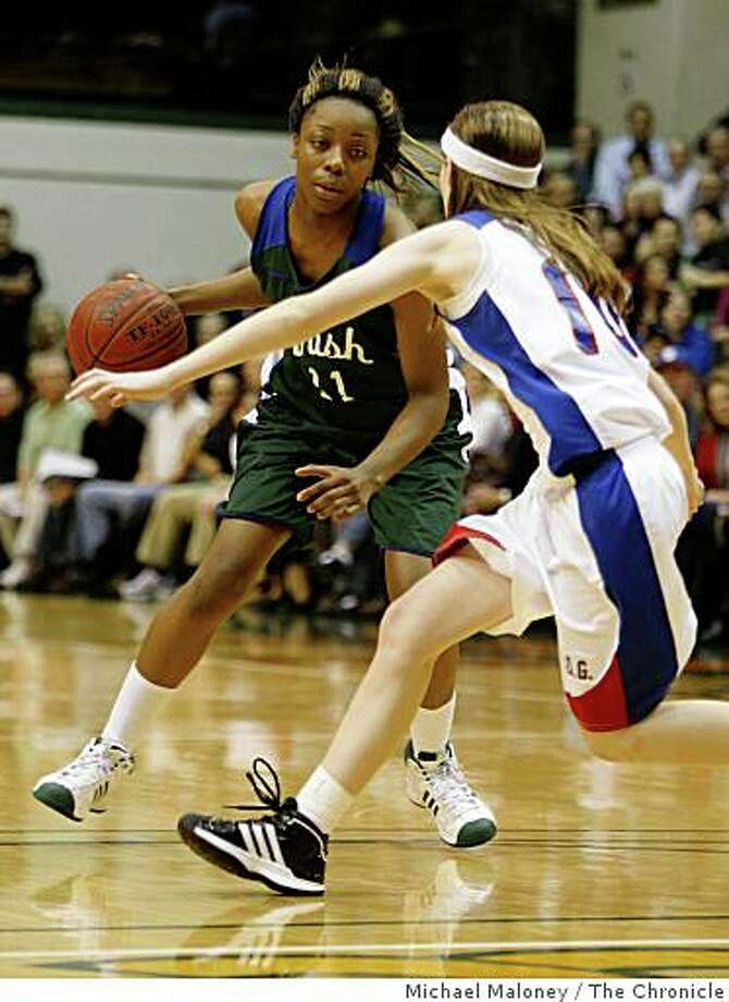 Sacred Heart Cathedral's Tierra Rogers (11) drives to the basket against St. Ignatius guard Elise O'Connor (10) as Sacred Heart Cathedral beat St. Ignatius in a high school basketball game at USF's Memorial Gym in San Francisco, Calif. on January 13, 2009. Photo: Michael Maloney, The Chronicle