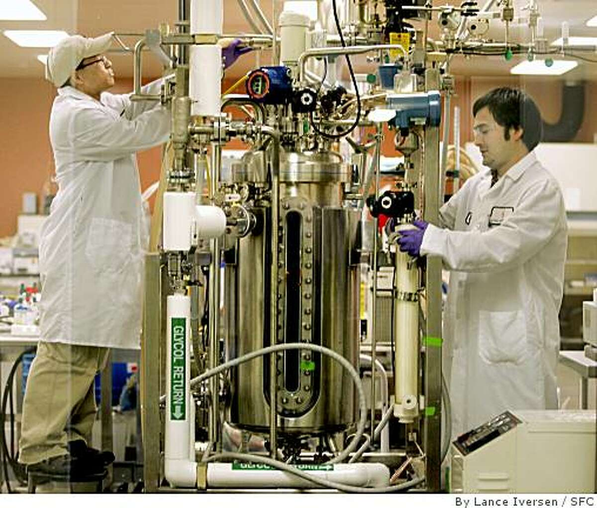 Technicians David Cheung and Jeff Norman work on a Bio Reactor at Cell Genesys, a South San Francisco biotech pharmaceutical company that develops health-care drugs.