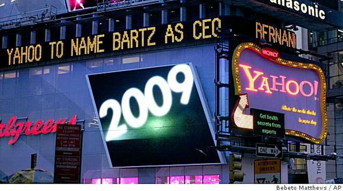 A news ticker in New York's Times Square displays an announcement that Yahoo will name Silicon Valley veteran Carol Bartz as its new CEO, Tuesday, Jan. 13, 2009. The decision, reported Tuesday by The Wall Street Journal, would end Yahoo's two-month search to replace co-founder Jerry Yang, who surrendered the CEO reins after potentially lucrative deals with rivals Microsoft Corp. and Google Inc. both collapsed. (AP Photos/Bebeto Matthews)