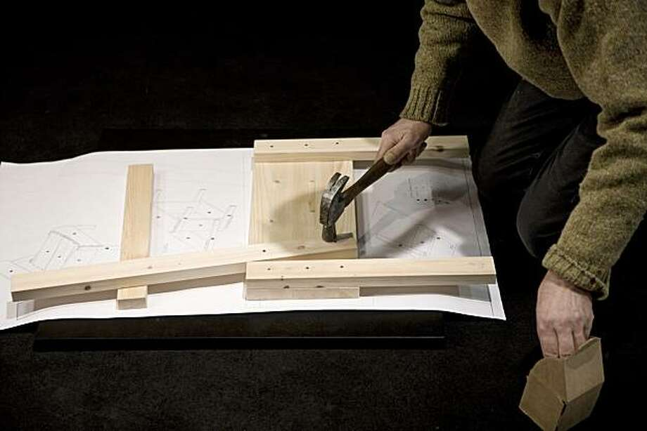 Enzo Mari puts together his Sedia 1 chair Photo: Courtesy Artek
