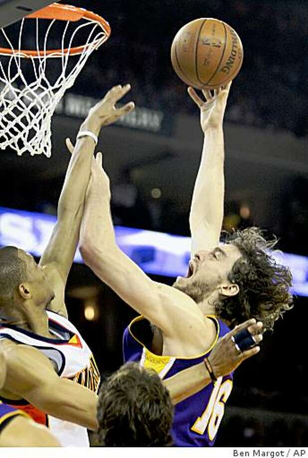 Los Angeles Lakers' Pau Gasol, right, of Spain, puts up a shot over Golden State Warriors' Brandan Wright during the second half of an NBA basketball game Wednesday, Jan. 7, 2009, in Oakland, Calif. (AP Photo/Ben Margot) Photo: Ben Margot, AP