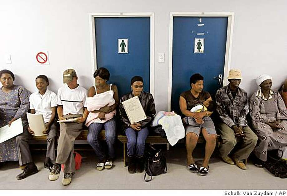 **APN ADVANCE FOR SUNDAY MARCH 23** People await treatment for different sickness at the Empilisweni Clinic that treat patient's for TB and HIV in Worcester, South Africa, Monday, Feb. 4, 2008. (AP Photo/Schalk van Zuydam) Photo: Schalk Van Zuydam, AP