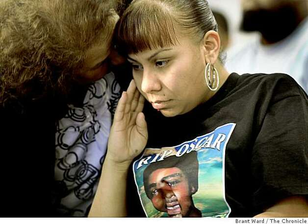 A family member tried to comfort Sophina Mesa, the mother of Oscar Grant's child, prior to Thursday's press conference. Members of Oscar Grant's family appeared at their lawyer's, John Burris, office to plead for peace. Several family members called for the violence, which plagued Wednesday nights protest, to end immediately. Photo: Brant Ward, The Chronicle
