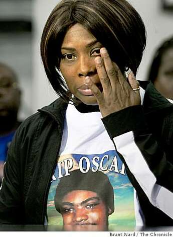 Wanda Johnson, the mother of Oscar Grant, tried to hold back tears as she listened to family members call for peace. Members of Oscar Grant's family appeared Thursday January 8, 2009 at their lawyer John Burris offices to plead for peace. Several family members called for the violence, which plagued Wednesday nights protest, to end immediately. Photo: Brant Ward, The Chronicle