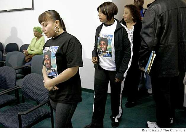 Family members including Sophina Mesa, left, (girlfriend), and Wanda Johnson, center, (mother) entered the press conference. Members of Oscar Grant's family appeared Thursday January 8, 2009 at their lawyer John Buress offices to plead for peace. Several family members called for the violence, which plagued Wednesday nights protest, to end immediately. Photo: Brant Ward, The Chronicle