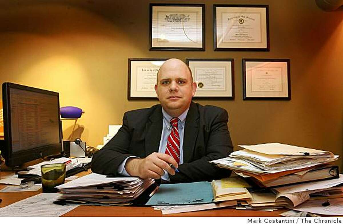 Attorney Tilden Moschetti sits at his desk in San Francisco, Calif. on Wednesday, December 24, 2008.
