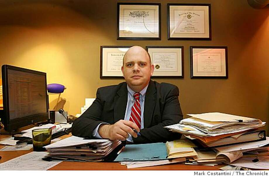 Attorney Tilden Moschetti sits at his desk in San Francisco, Calif. on Wednesday, December 24, 2008. Photo: Mark Costantini, The Chronicle
