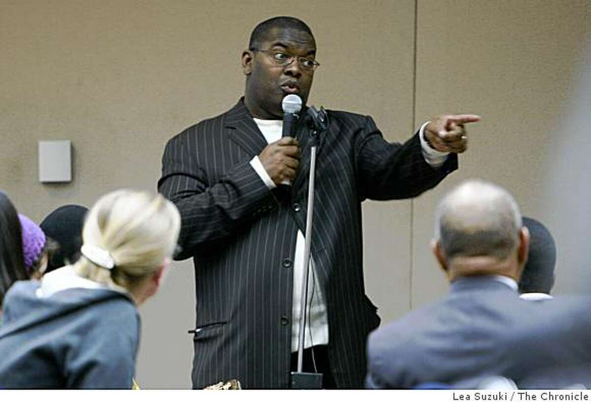 Reverend Dion Evans of Alameda's Chosen Vessels Christian Church speaks during a community meeting in response to the shooting of Oscar Grant in the Lawrence D. Dahms Auditorium at the Joseph P. Bort MetroCenter in Oakland, Calif. on Sunday January 11 ,2009.