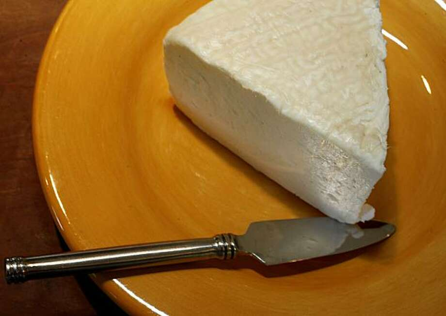 Tomme Perigourdine is a white creamy goats milk cheese from France. Photo: Brant Ward, The Chronicle