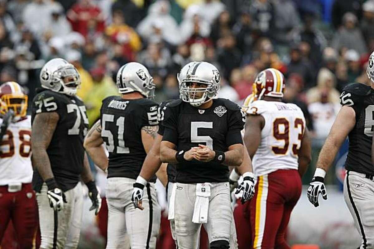 Oakland Raiders quarterback Bruce Gradkowski between plays against the Washington Redskins, Sunday Dec. 13, 2009, in Oakland, CAlif.