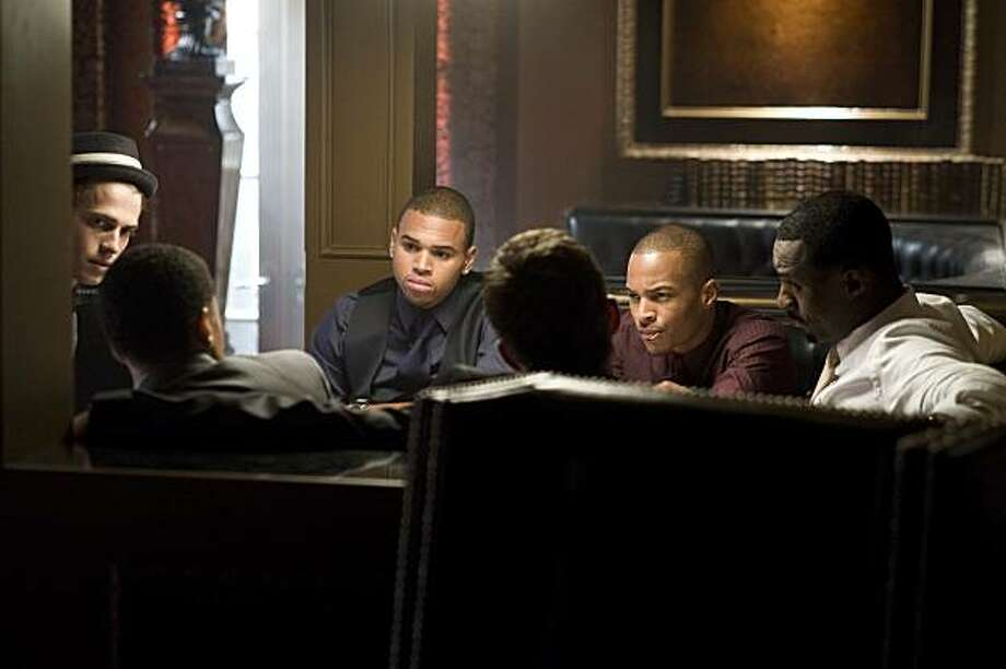 "(l to r) Hayden Christensen, Chris Brown, Tip ""T.I."" Harris and Idris Elba star in Screen Gems' action thriller TAKERS. Photo: Suzanne Tenner, Screen Gems"