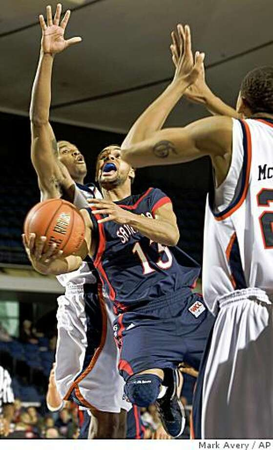 Saint Mary's guard Patrick Mills, center, puts a lay up under UTEP guard Stefon Jackson, left, in the second half of an NCAA basketball game during the 76 Classic tournament in Anaheim, Calif., Thursday, Nov. 27, 2008. (AP Photo/Mark Avery) Photo: Mark Avery, AP