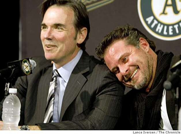 Oakland Athletics' new designated hitter Jason Giambi, right, leans on the shoulder of A's general manager Billy Beane after Beane said the returning Giambi is like marrying his first wife again, who he has a great relationship with. The pair along with team manager Bob Geren spoke at a press conference in Oakland, Calif., Wednesday, Jan. 7, 2009. Photo: Lance Iversen, The Chronicle