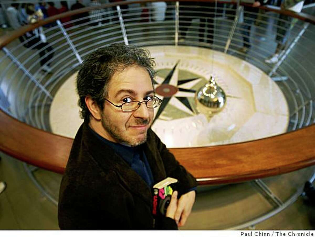 Brain Malow visits the Foucault pendulum at the Academy of Sciences in San Francisco, Calif., on Friday, Nov. 21, 2008. Known for his science-themd comedy, one of Malow's latest shows is titled,