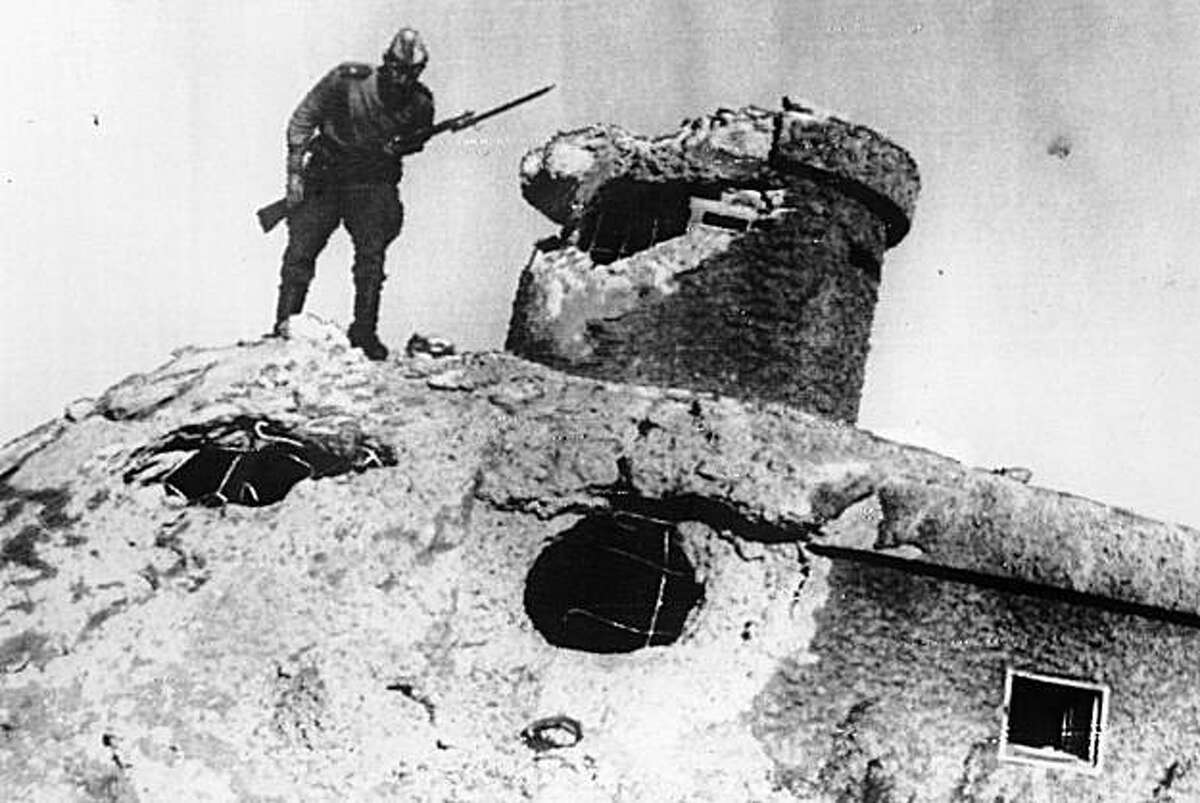 ** ADVANCE FOR USE SUNDAY, AUG. 15, 2010 AND THEREAFTER ** FILE - In this Thursday, Aug. 23, 1945 picture, a Soviet Red Army soldier peers over the edge of a Japanese fort, at an unknown location in China. On Aug. 8, 1945, the Soviet Union officially declared war on Japan and invaded Japanese-occupied Manchuria in northeastern China. In recent years some historians have argued that a Soviet surprise attack on the Japanese army occupying eastern Asia served as effectively as _ or possibly more than _ the atomic bombs in ending the war.