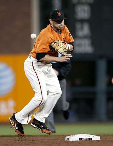 Freddy Sanchez bobbles the ball at second base committing the Giants second error of the game as the San Francisco Giants take on the Arizona Diamondbacks at AT&T Park in San Francisco, Calif., on Friday, August 27, 2010. Photo: Chad Ziemendorf, The Chronicle