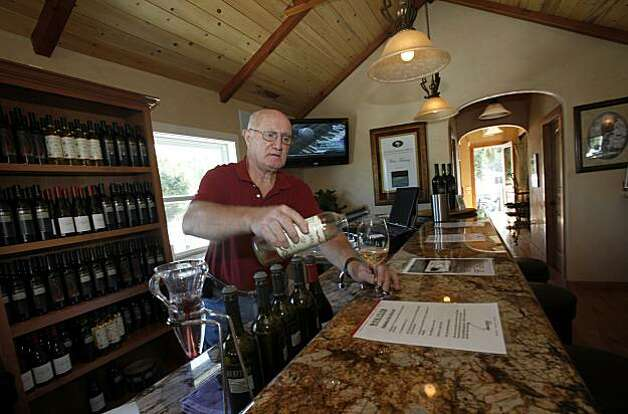 John Ross pours at one of the many wine tasting outlets, Uncorked at the Oxbow. Napa, Calif. is one of the most visited cities in the Bay Area and features fine restaurants, wineries, a renovated downtown and scenic vineyards. Photo: Brant Ward, The Chronicle